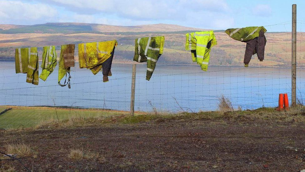 Work jackets on a wire fence