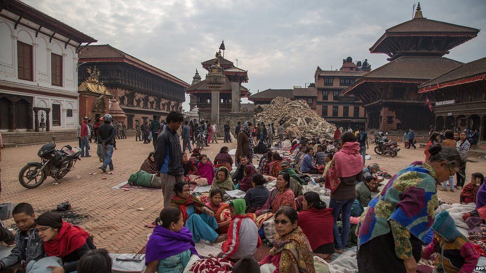 Residents sit in a square on April 26, 2015 in Bhaktapur, Nepal