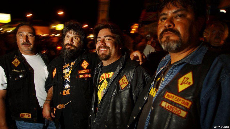 Four Bandido member wearing their biker jackets