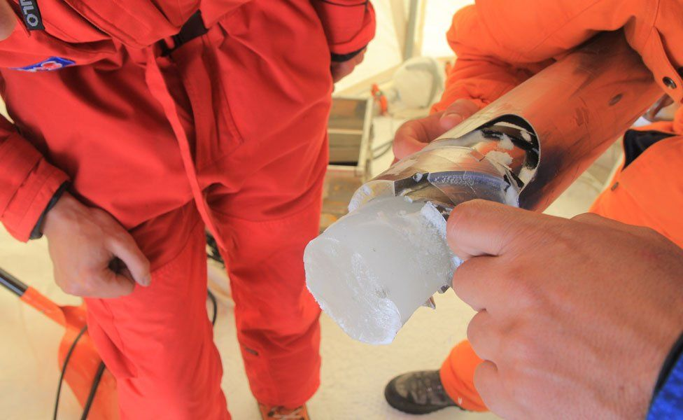 An ice core in the drilling chamber
