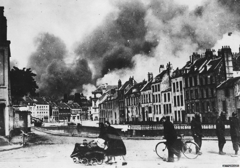 12th June 1940: Refugees fleeing during the German aerial bombardment of Dunkirk.