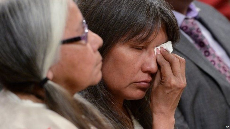 A woman wipes a tear during the closing ceremony of the Indian Residential Schools Truth and Reconciliation Commission, at Rideau Hall in Ottawa on 3 June.
