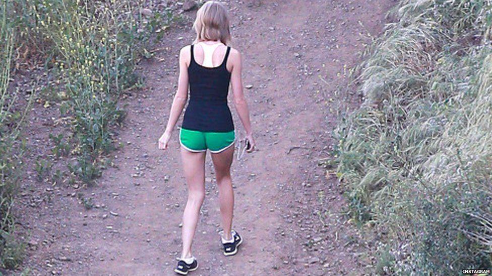 Taylor Swift walking backwards