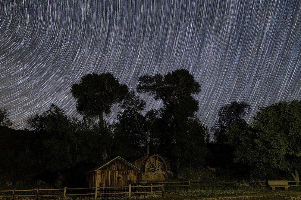 Waterwheel under the night sky