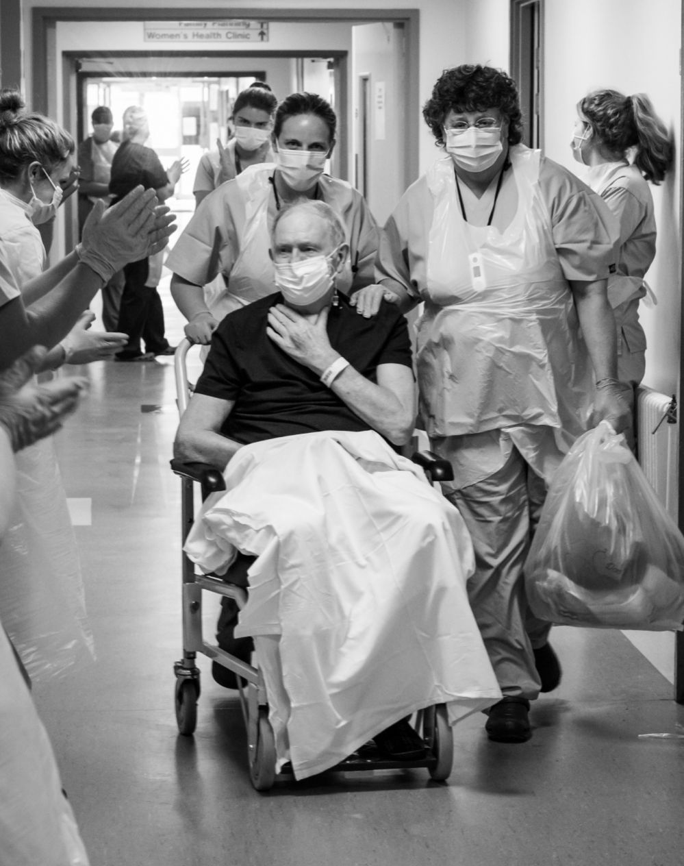 A patient is clapped while leaving the ITU