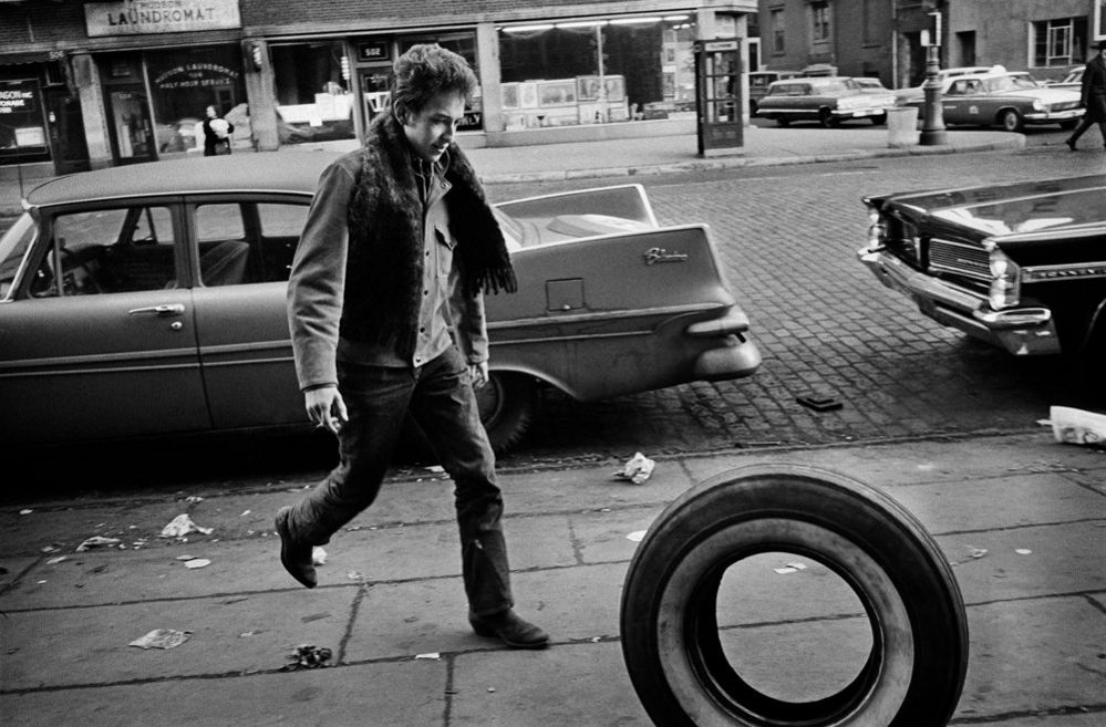 Bob Dylan rolling the tire, Greenwich Village, New York City, 1963