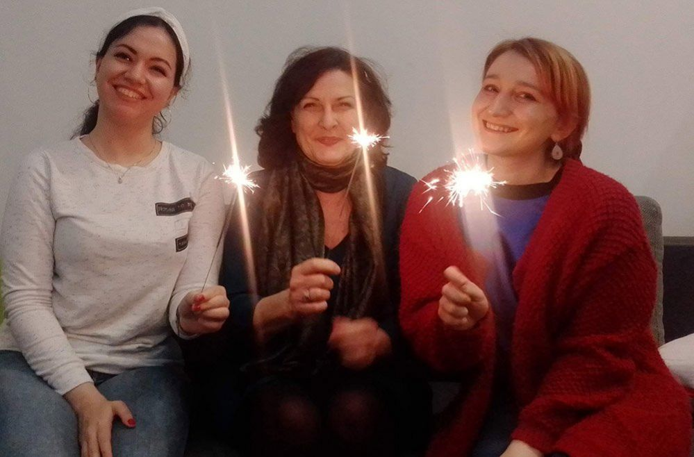 Three women with candles