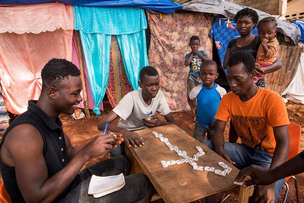 People play dominoes