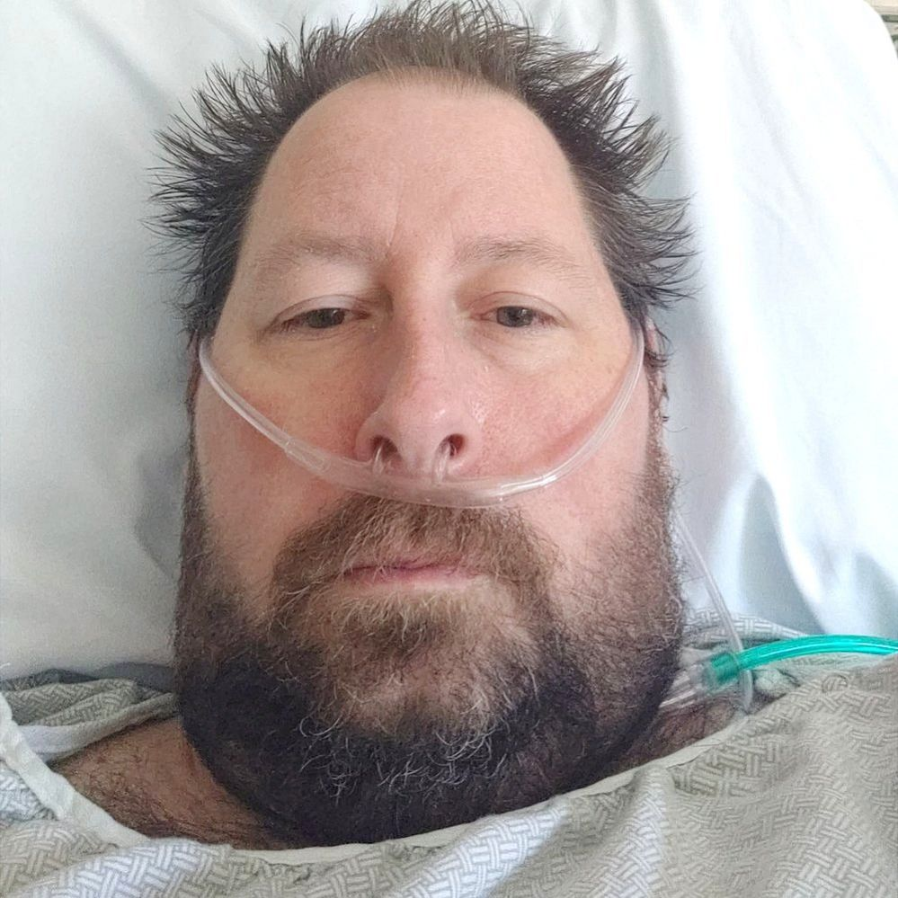 Brian in a hospital bed
