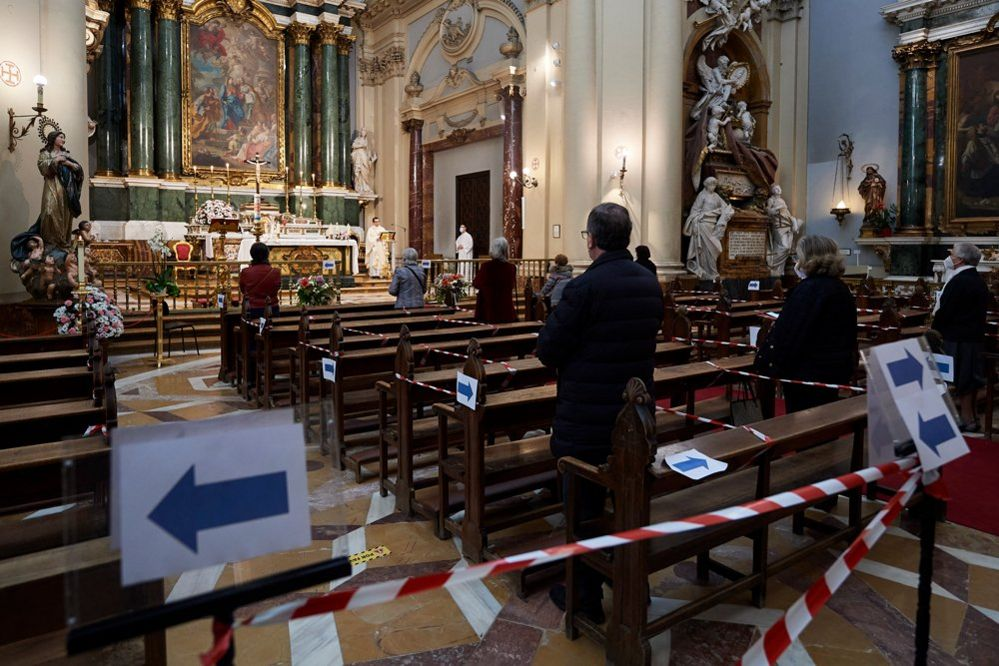 People attend mass in a church