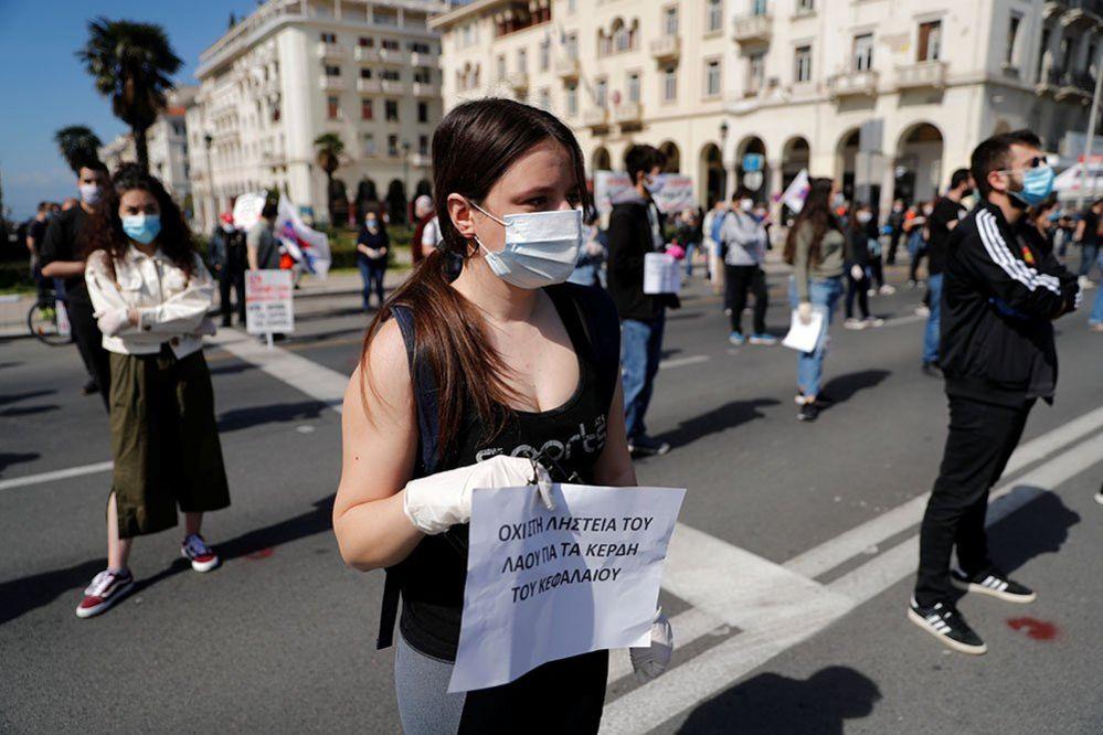 Demonstrators practice social distancing