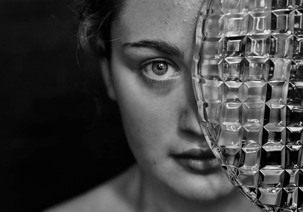Woman with a plate covering half of her face
