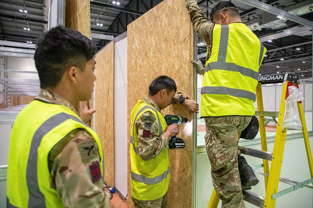 Members of the Queen's Ghurka Engineers Regiment construct cubicles