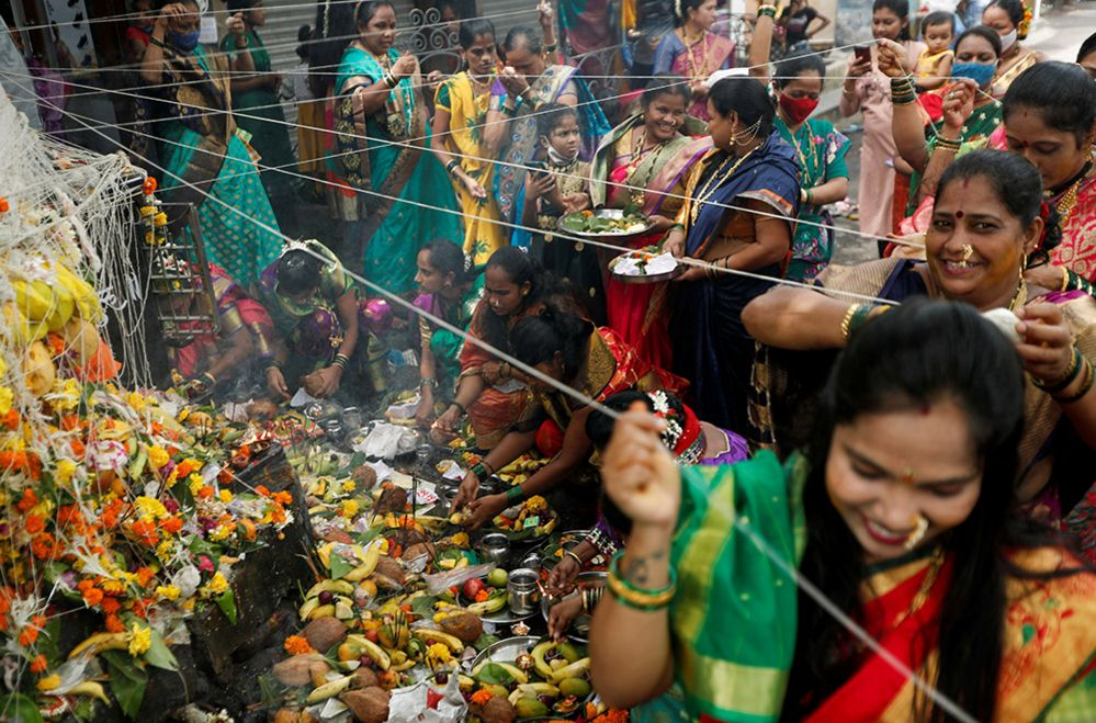 Women offering prayers in Mumbai