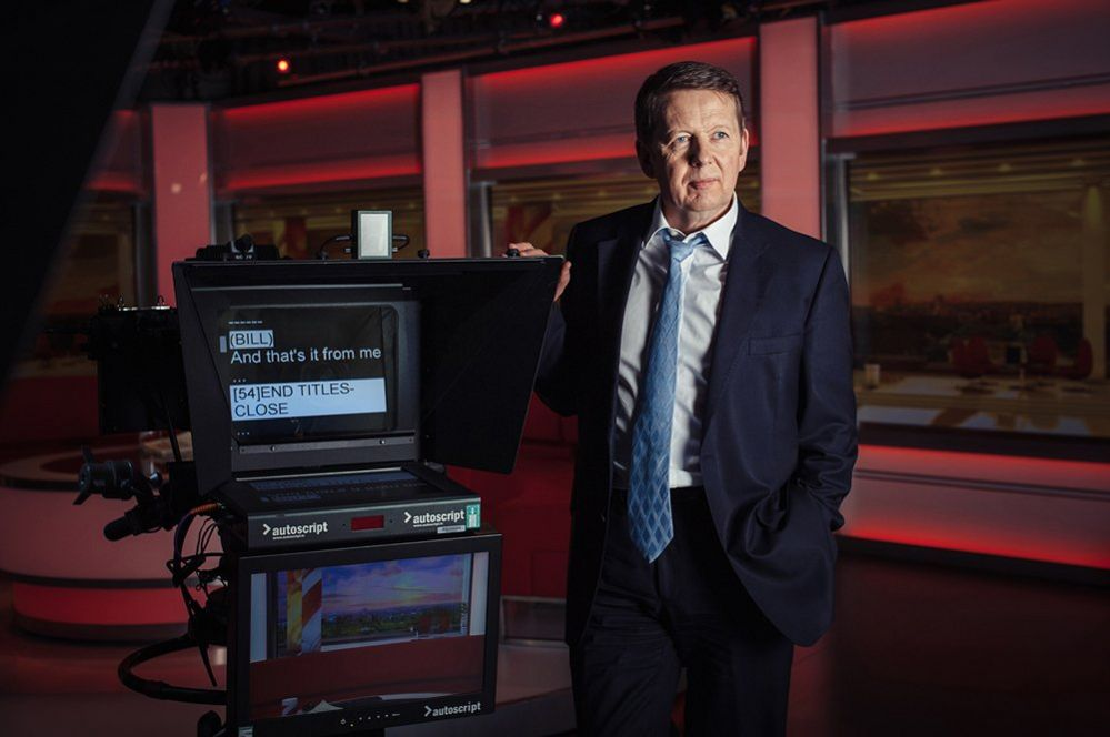 Bill Turnbull standing next to an autocue