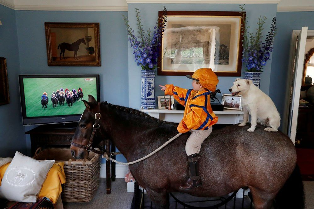 Merlin Coles on his horse inside the house