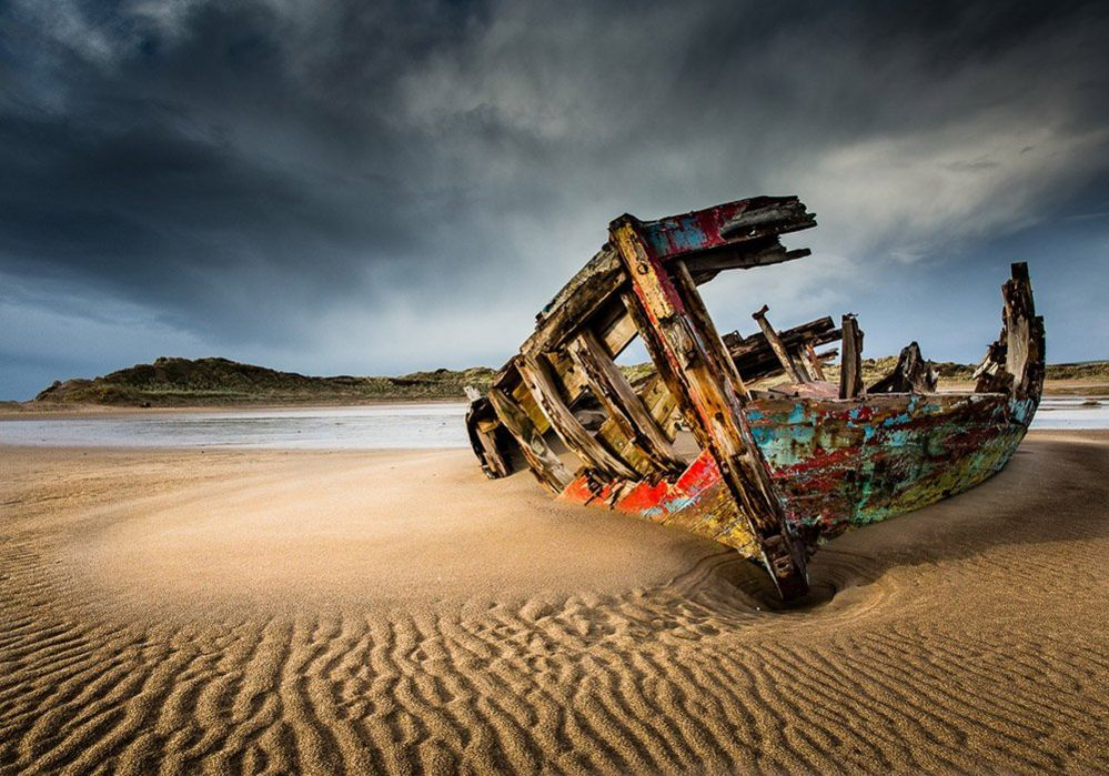 Derelict boat on the shore