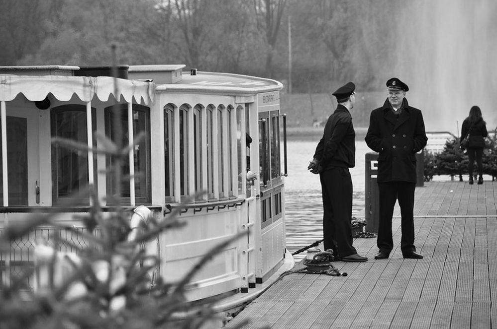 Two men beside an old steamer