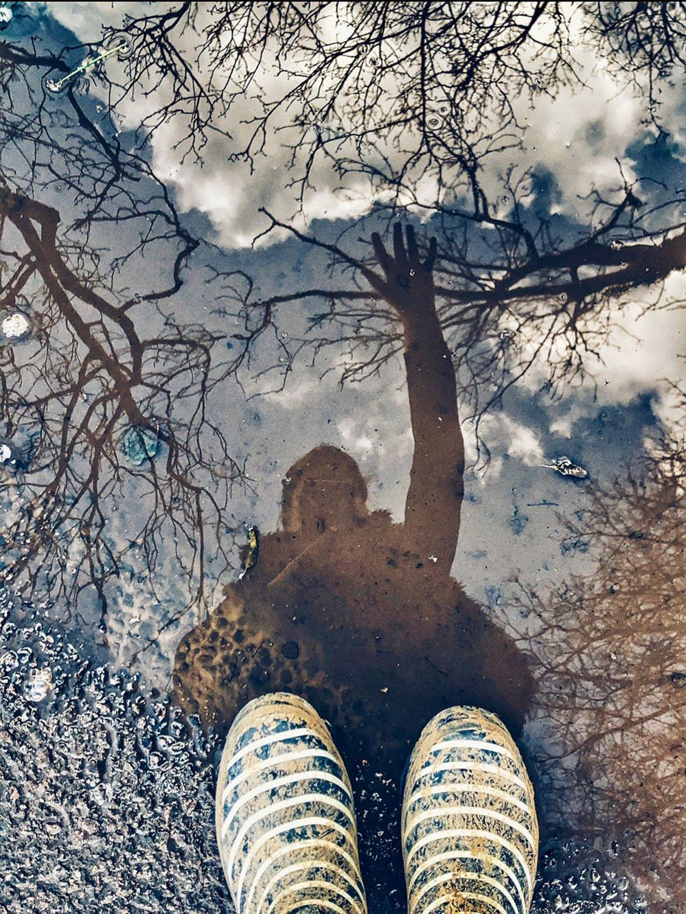 Boots and a puddle