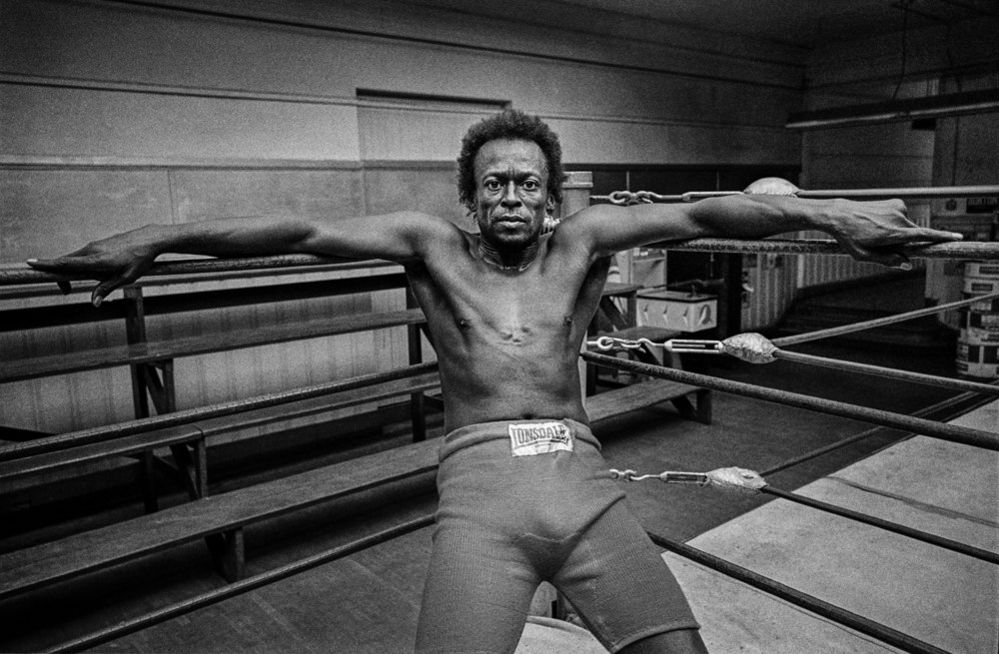 Miles Davis in boxing ring Newman's gym, San Francisco, 1971