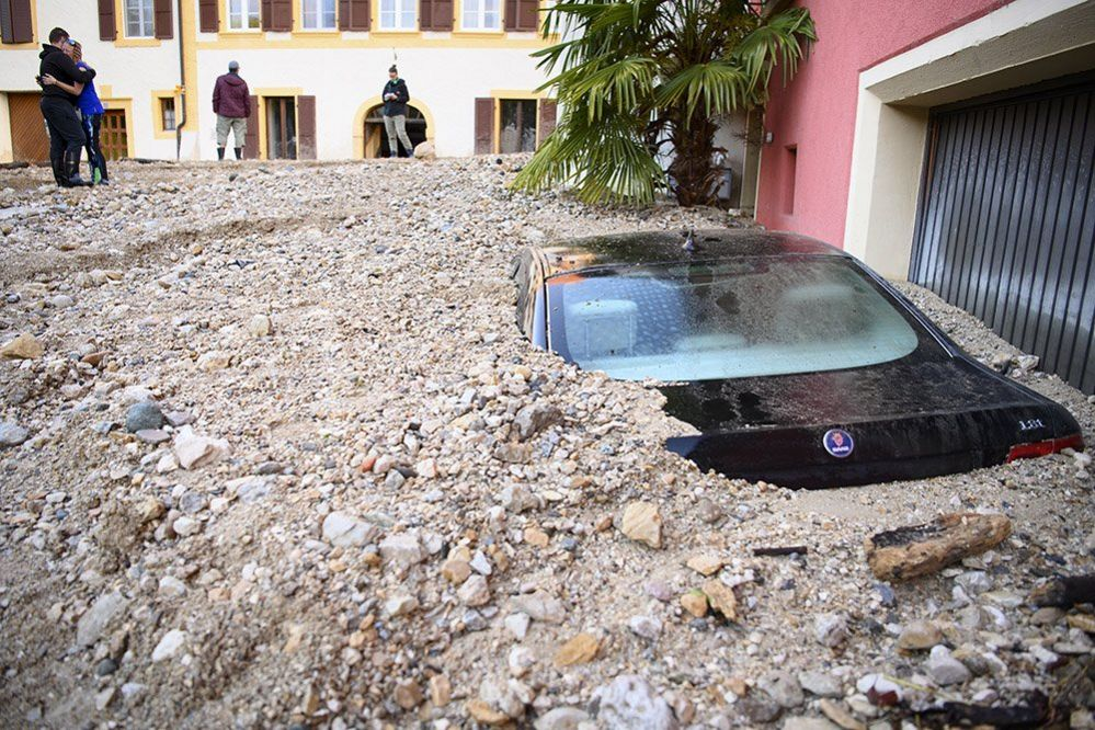 A car buried in rubble