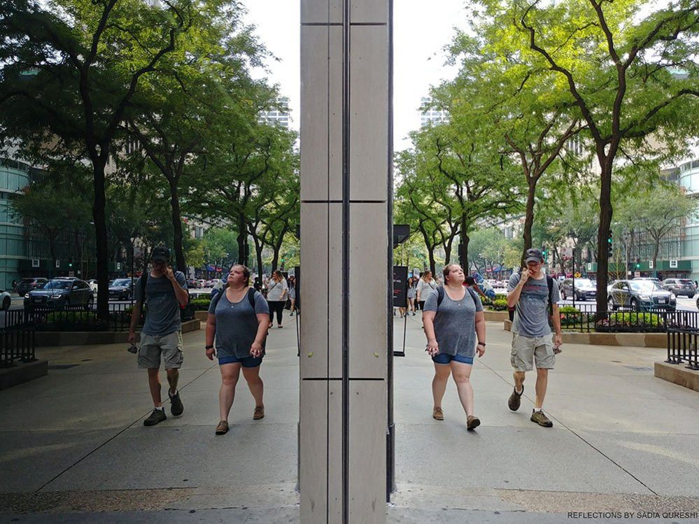 Couple Reflecting in glass window, Chicago, Illinois