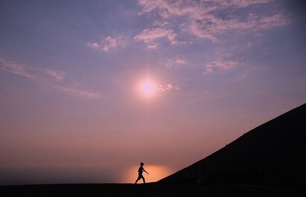 Figure against the horizon