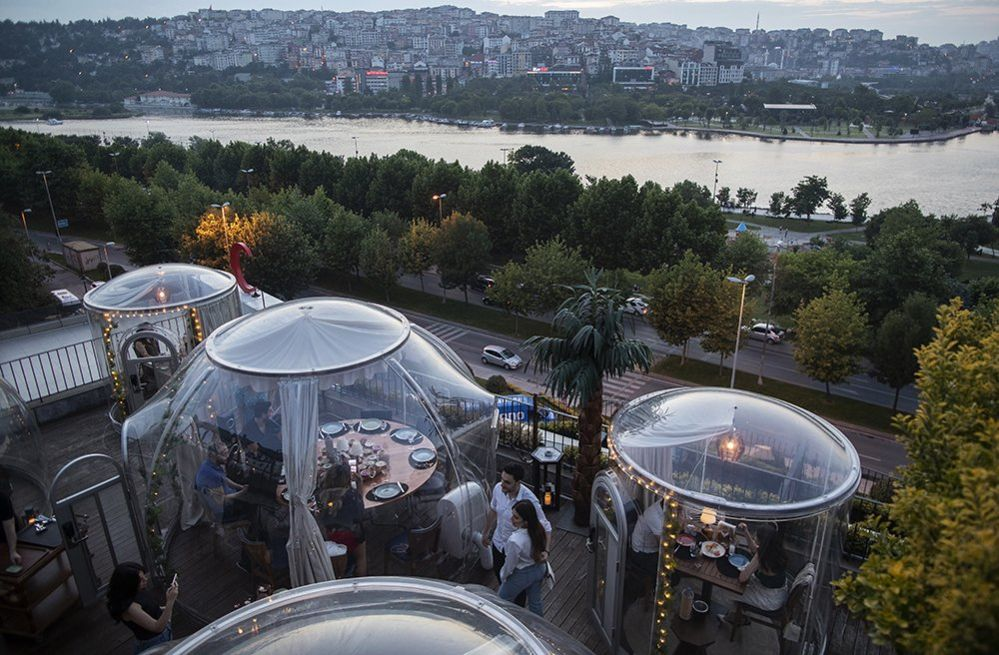 Diners in domes at a restaurant in Istanbul