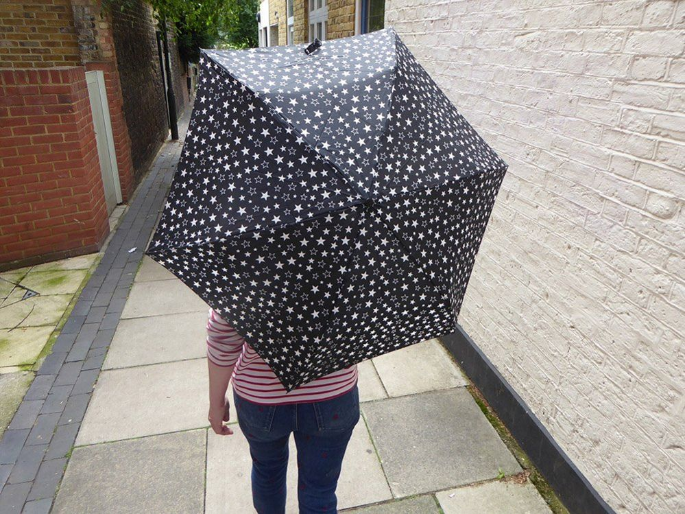 Woman with a star umbrella