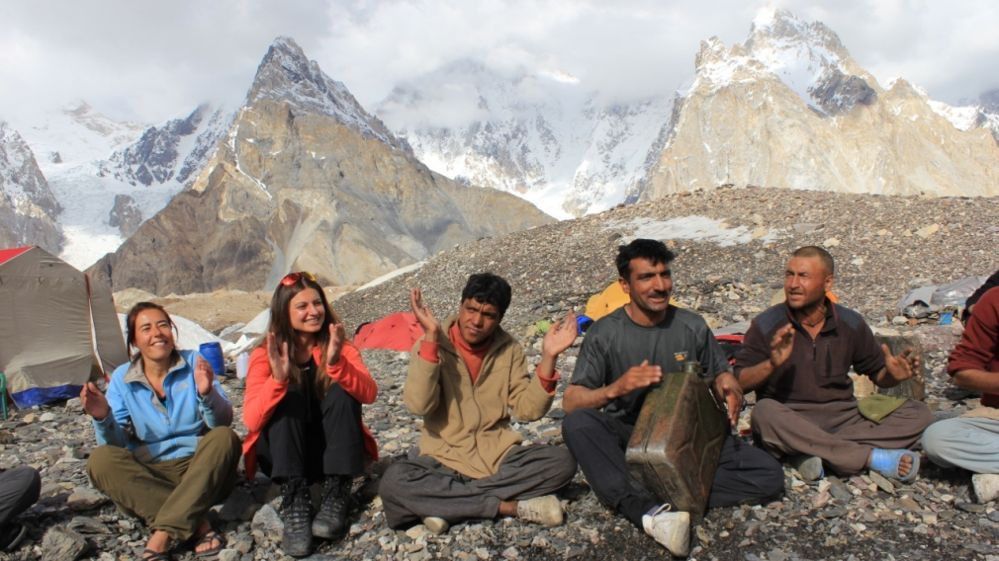 Ali Sadpara playing drums on a jerry can with a Dutch group during a K2 trek at a point called Concordia - July 2012