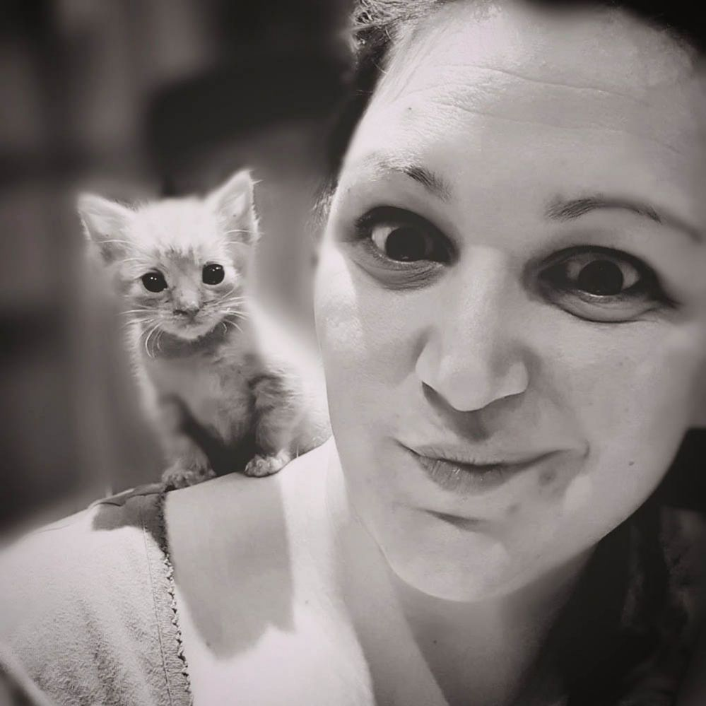 Woman with a cat on her shoulder