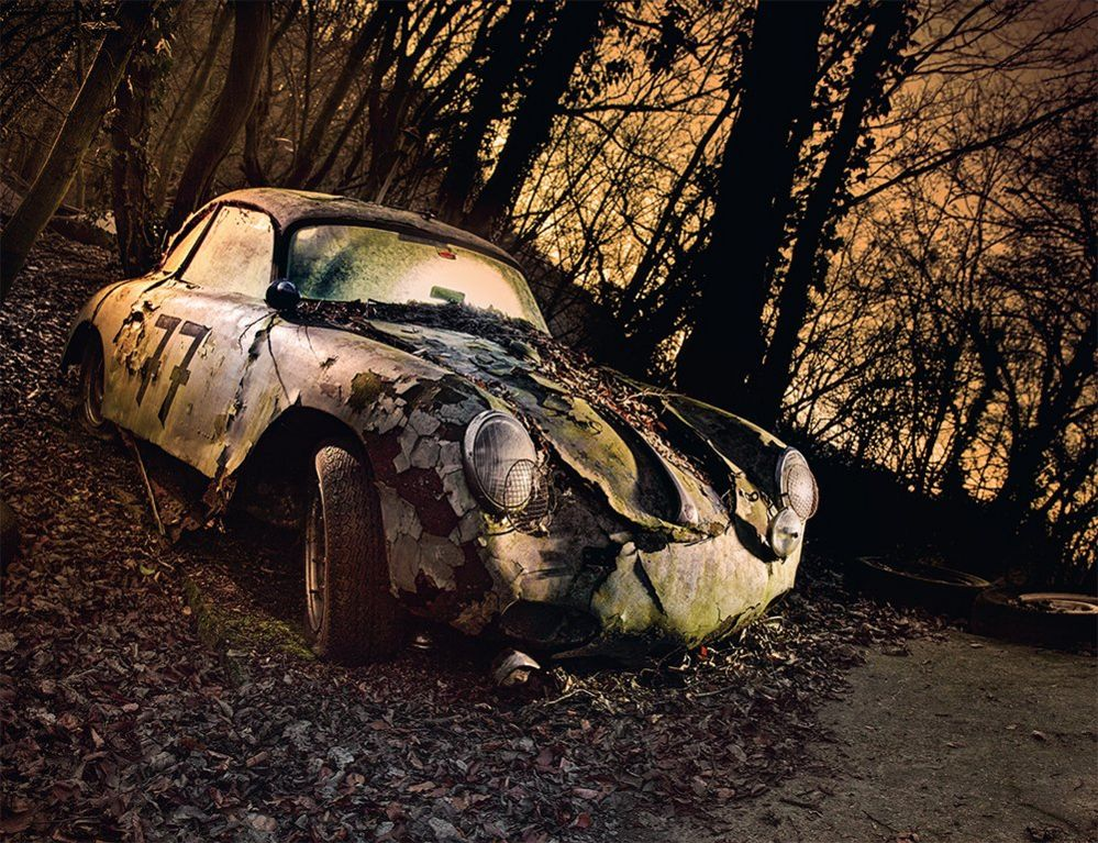 An abandoned car in a forest