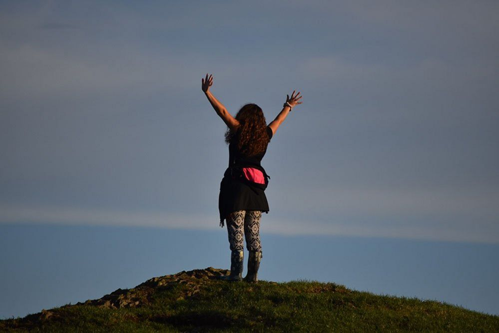 Woman at the top of a hill
