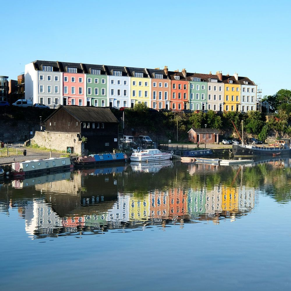 Colourful houses reflected in water