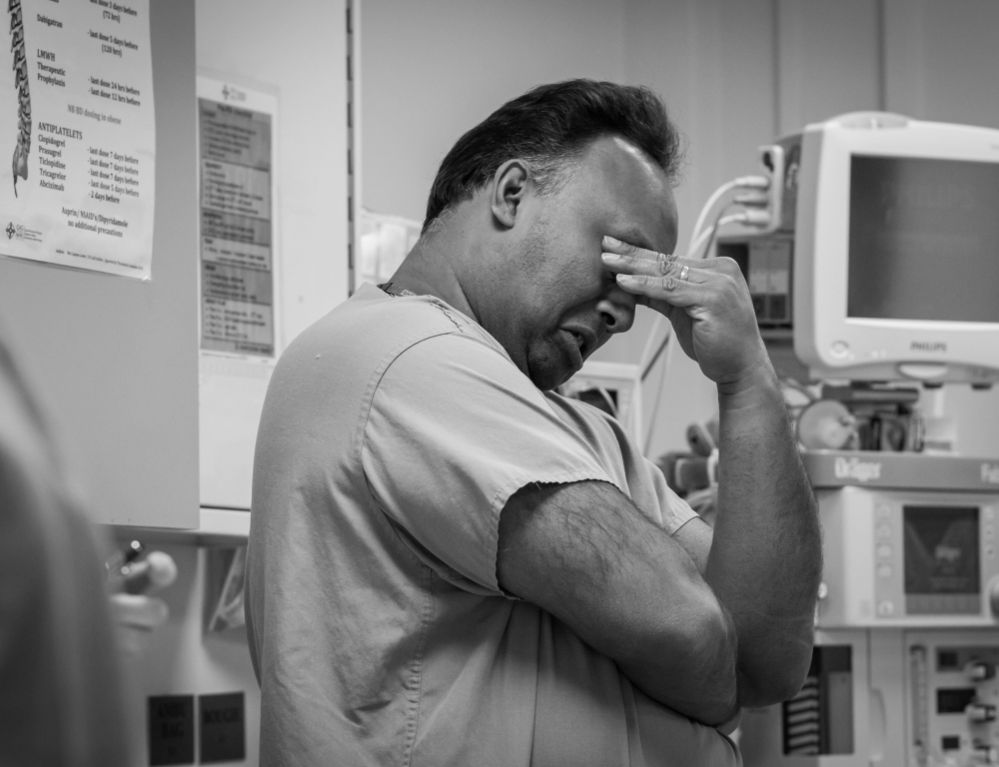 A medic rubs his eyes on the intensive therapy unit