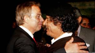 Prime Minister Tony Blair (left) embraces Colonel Muammar Gaddafi after a meeting on 29 May 2007 in Sirte, Libya