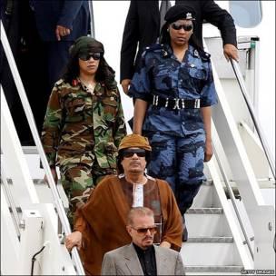 Libyan leader Muammar Gaddafi, escorted by female bodyguards, arrives in Italy, 29 August 2010