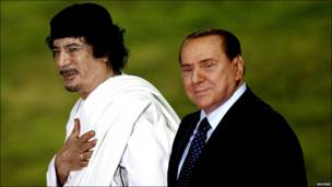 Italy's Prime Minister Silvio Berlusconi and Libyan leader Muammar Gaddafi review an honour guard in Rome, 30 August 2010