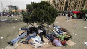 بالصور: فض اعتصام ميدان التحرير بالقوة
