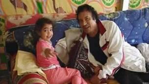 Каддафи с внучкой