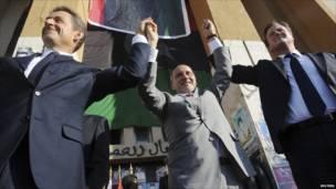 Слева направо: Николя Саркози, Мустафа Джалиль и Дэвид Кэмерон