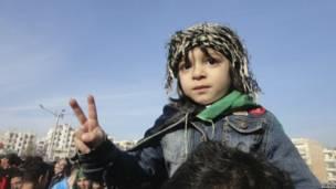 Ребенок на демонстрации против режима Башара Асада в городе Адиб 16 декабря 2011 года