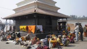 Sadhus taking shelther at a Ram temple