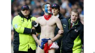 Naked supported escorted off pitch in Scotland
