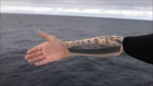 tatooed arm
