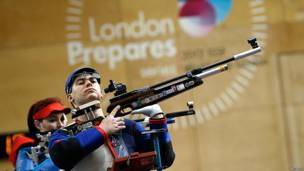 An athlete holds his rifle during a training session