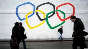 The Olympic rings painted on a white wall