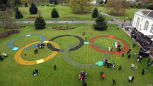 Aerial view of flower beds in the shape of the Olympic rings