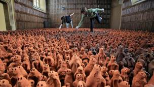 Thousands of clay sculptures are prepared by two women