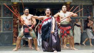Actors perform on-stage at The Globe theatre